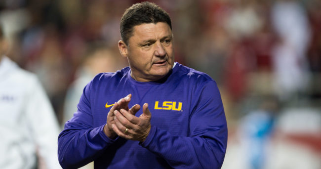 Nov 12, 2016; Fayetteville, AR, USA; LSU Tigers head coach Ed Orgeron walks onto the field to watch his players warmup before the game against the Arkansas Razorbacks at Donald W. Reynolds Razorback Stadium. Mandatory Credit: Brett Rojo-USA TODAY Sports