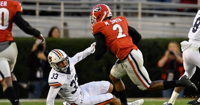Nov 12, 2016; Athens, GA, USA; Georgia Bulldogs defensive back Maurice Smith (2) runs past Auburn Tigers receiver Will Hastings (33) after intercepting a pass and returning it for a touchdown during the second half at Sanford Stadium. Georgia defeated Auburn 13-7. Mandatory Credit: Dale Zanine-USA TODAY Sports