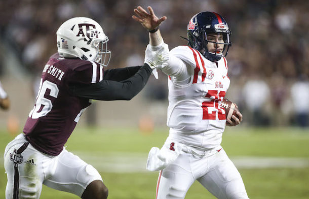 Nov 12, 2016; College Station, TX, USA; Mississippi Rebels quarterback Shea Patterson (20) runs with the ball as Texas A&M Aggies defensive back DeShawn Capers-Smith (26) defends during the second quarter at Kyle Field. Mandatory Credit: Troy Taormina-USA TODAY Sports
