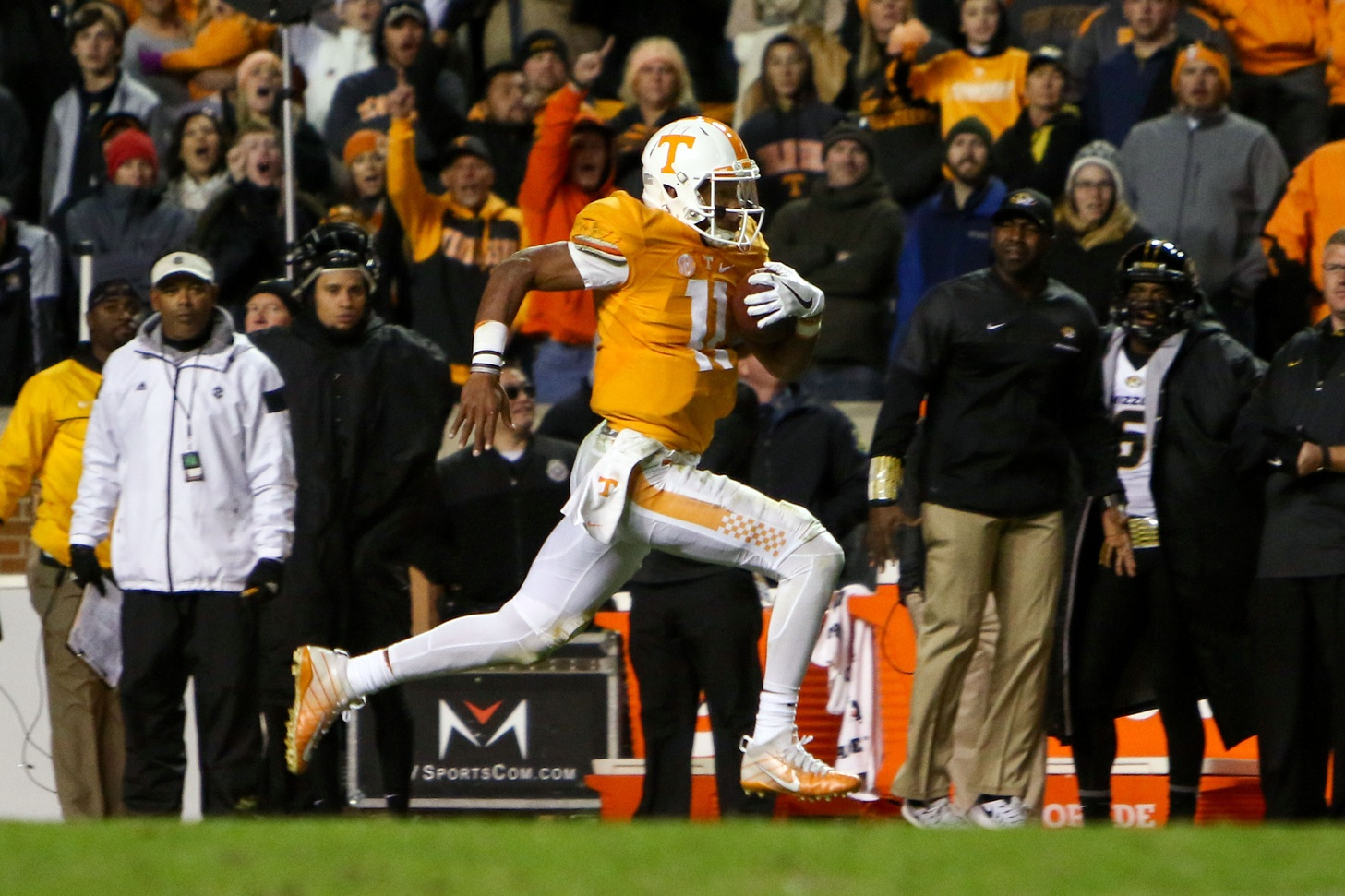 Nov 19, 2016; Knoxville, TN, USA; Tennessee Volunteers quarterback Joshua Dobbs (11) runs for a touchdown against the Missouri Tigers during the second half at Neyland Stadium. Tennessee won 63 to 37. Mandatory Credit: Randy Sartin-USA TODAY Sports