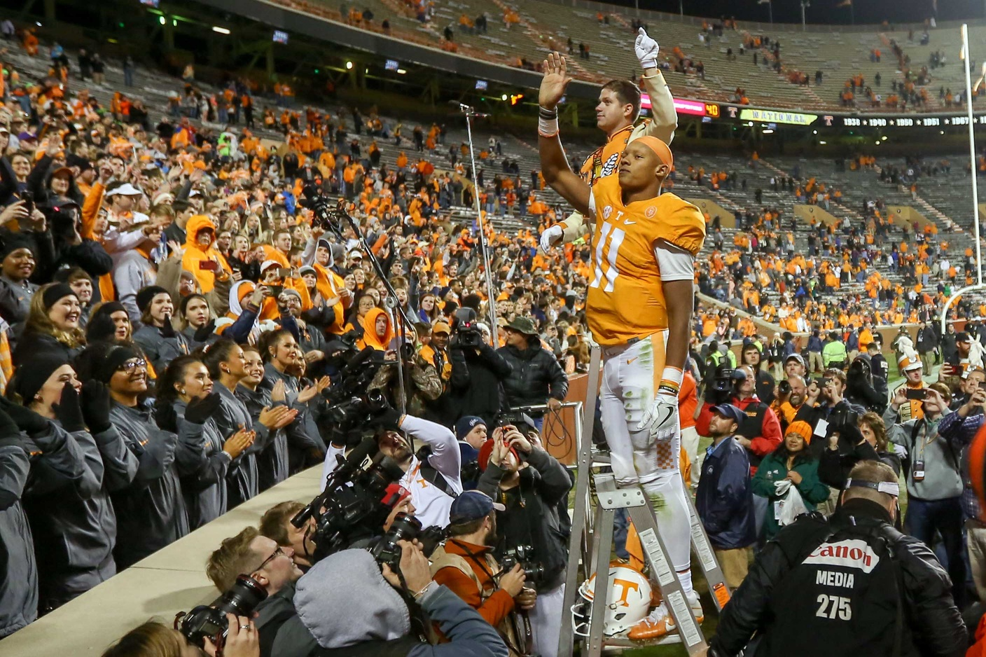 Nov 19, 2016; Knoxville, TN, USA; Tennessee Volunteers quarterback Joshua Dobbs (11) directs the band after the game against the Missouri Tigers at Neyland Stadium. Tennessee won 63 to 37. Mandatory Credit: Randy Sartin-USA TODAY Sports