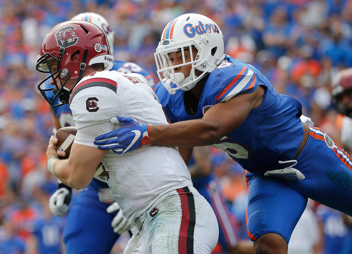 Nov 12, 2016; Gainesville, FL, USA; Florida Gators defensive back Quincy Wilson (6) tackles South Carolina Gamecocks quarterback Jake Bentley (4) during the second half at Ben Hill Griffin Stadium. Florida Gators defeated the South Carolina Gamecocks 20-7. Mandatory Credit: Kim Klement-USA TODAY Sports