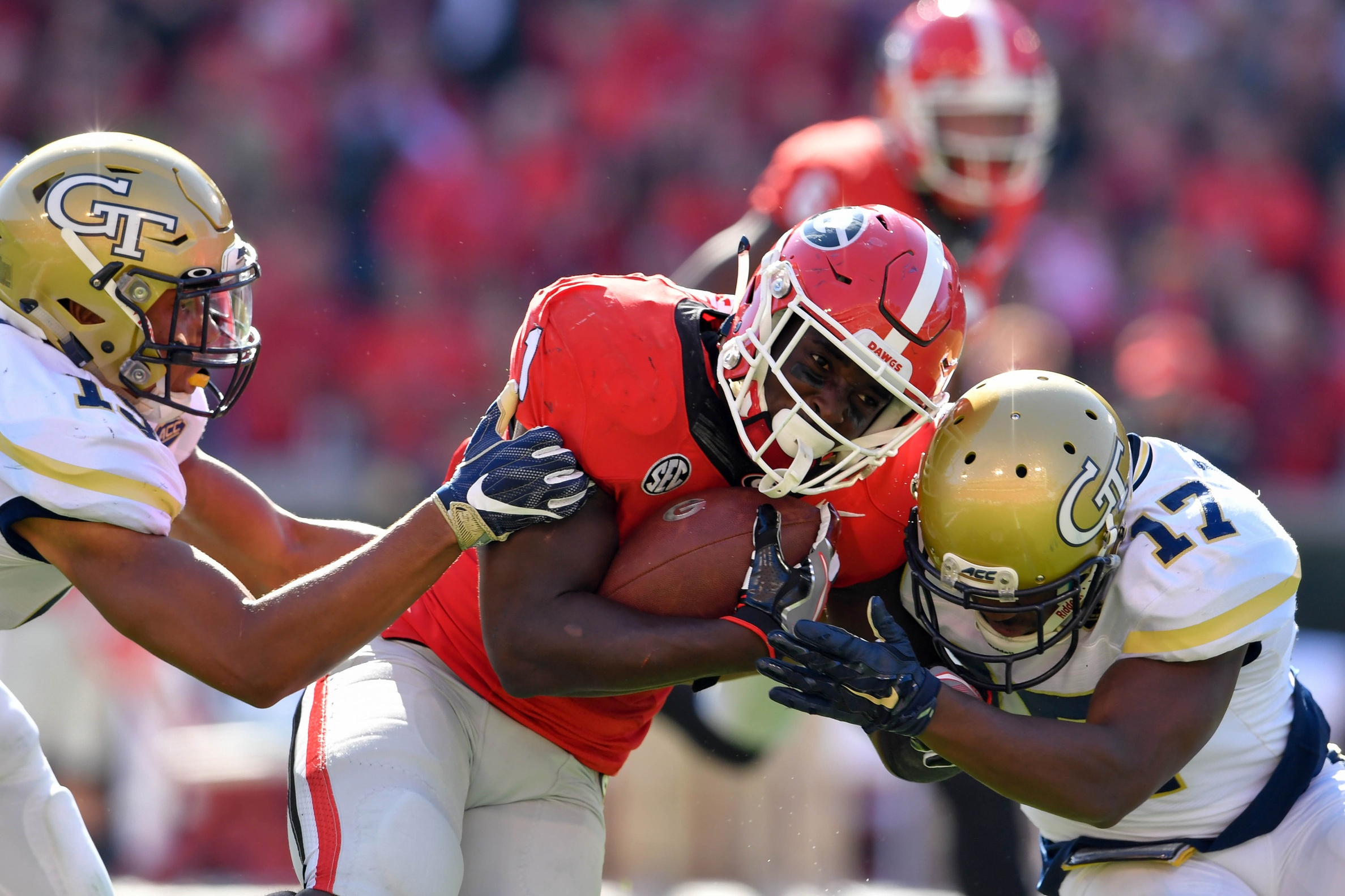 Nov 26, 2016; Athens, GA, USA; Georgia Bulldogs running back Sony Michel (1) is tackled by Georgia Tech Yellow Jackets defensive back A.J. Gray (15) and defensive back Lance Austin (17) after a long run during the second quarter at Sanford Stadium. Mandatory Credit: Dale Zanine-USA TODAY Sports