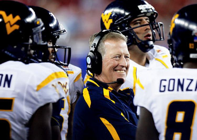 Dec 28, 2010; Orlando, FL, USA; West Virginia Mountaineers head coach Bill Stewart watches play against the North Carolina State Wolfpack during the third quarter of the 2010 Champs Sports Bowl at the Citrus Bowl. North Carolina State defeated West Virginia 23-7. Mandatory Credit: Douglas Jones-USA TODAY Sports