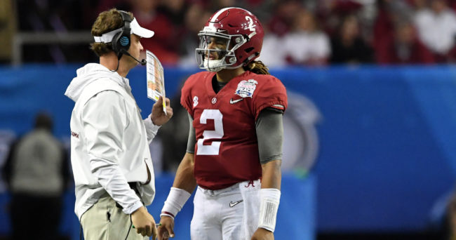 Dec 31, 2016; Atlanta, GA, USA;  Alabama Crimson Tide offensive coordinator Lane Kiffin talks with quarterback Jalen Hurts (2) during the third quarter in the 2016 CFP semifinal against the Washington Huskies at the Peach Bowl at the Georgia Dome. Mandatory Credit: John David Mercer-USA TODAY Sports
