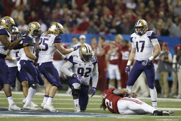 Dec 31, 2016; Atlanta, GA, USA; Alabama Crimson Tide quarterback Jalen Hurts (2) lays on the field after being brought down by Washington Huskies defensive lineman Jaylen Johnson (92) during the third quarter in the 2016 CFP Semifinal at the Georgia Dome. Mandatory Credit: Jason Getz-USA TODAY Sports