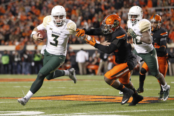 Nov 21, 2015; Stillwater, OK, USA; Baylor Bears quarterback Jarrett Stidham (3) tries to avoid the tackle of Oklahoma State Cowboys linebacker Jordan Burton (20) in the second quarter at Boone Pickens Stadium. Mandatory Credit: Tim Heitman-USA TODAY Sports
