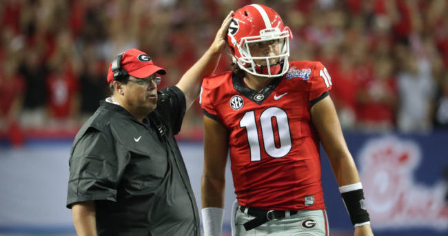 Sep 3, 2016; Atlanta, GA, USA; Georgia Bulldogs offensive cordinator Jim Chaney talks with quarterback Jacob Eason (10) on the sideline during the third quarter of the 2016 Chick-Fil-A Kickoff game against the North Carolina Tar Heels at Georgia Dome. Mandatory Credit: Jason Getz-USA TODAY Sports