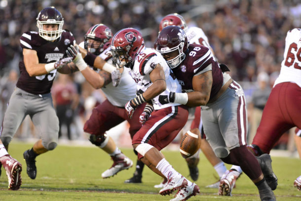 Sep 10, 2016; Starkville, MS, USA; Mississippi State Bulldogs defensive lineman Jeffery Simmons (98) forces a fumble as he hits South Carolina Gamecocks running back A.J. Turner (25) during the second quarter of the game at Davis Wade Stadium. Mandatory Credit: Matt Bush-USA TODAY Sports