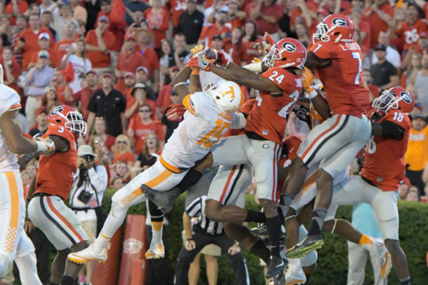 Oct 1, 2016; Athens, GA, USA; Tennessee Volunteers wide receiver Jauan Jennings (15) catches a game winning touchdown pass in front of Georgia Bulldogs safety Dominick Sanders (24) on the last play on the game during the fourth quarter at Sanford Stadium. Tennessee defeated Georgia 34-31. Mandatory Credit: Dale Zanine-USA TODAY Sports