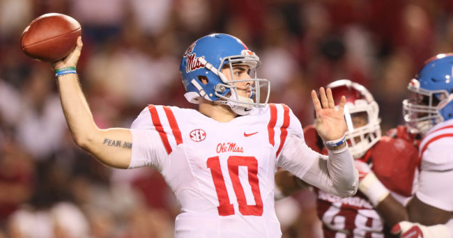 Oct 15, 2016; Fayetteville, AR, USA;  Ole Miss Rebels quarterback Chad Kelly (10) passes in the second quarter against the Arkansas Razorbacks at Donald W. Reynolds Razorback Stadium. Mandatory Credit: Nelson Chenault-USA TODAY Sports