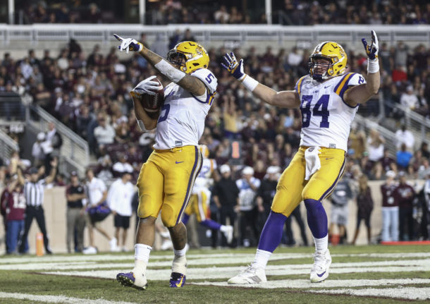 Nov 24, 2016; College Station, TX, USA; LSU Tigers running back Derrius Guice (5) points to the crowd after scoring a touchdown during the third quarter against the Texas A&M Aggies at Kyle Field. Mandatory Credit: Troy Taormina-USA TODAY Sports