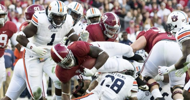 Nov 26, 2016; Tuscaloosa, AL, USA; Alabama Crimson Tide running back Bo Scarbrough (9) is hit by Auburn Tigers defensive back Tray Matthews (28)at Bryant-Denny Stadium. Mandatory Credit: Marvin Gentry-USA TODAY Sports