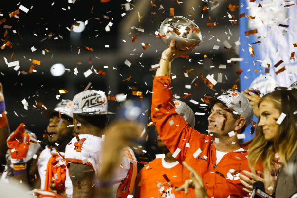 Dec 3, 2016; Orlando, FL, USA; Clemson Tigers head coach Dabo Swinney (right) holds up the ACC Championship trophy after a beating the Virginia Tech Hokies at Camping World Stadium. Clemson Tigers won 42-35. Mandatory Credit: Logan Bowles-USA TODAY Sports