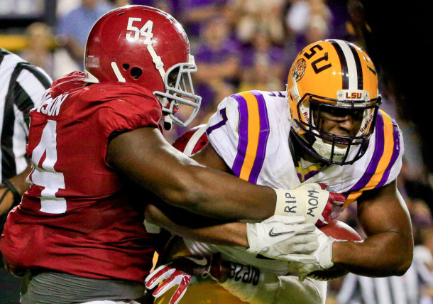 Nov 5, 2016; Baton Rouge, LA, USA; LSU Tigers running back Leonard Fournette (7) is tackled by Alabama Crimson Tide defensive lineman Dalvin Tomlinson (54) during the third quarter of a game at Tiger Stadium. Alabama defeated LSU 10-0. Mandatory Credit: Derick E. Hingle-USA TODAY Sports