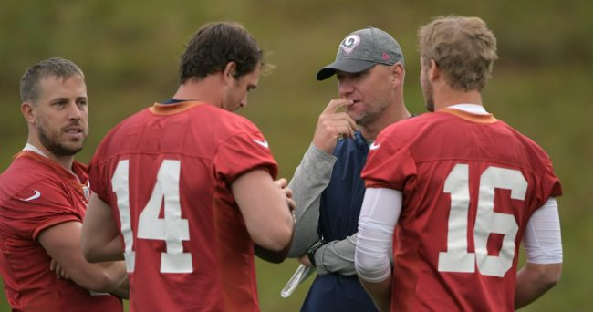 Oct 20, 2016; Bagshot, United Kingdom; Los Angeles Rams quarterback coach Chris Weinke (second from right) talks with Case Keenum (17), Sean Mannion (14) and Jared Goff (16) at practice at the Pennyhill Park Hotel & Spa in preparation for the NFL International Series game against the New York Giants. Mandatory Credit: Kirby Lee-USA TODAY Sports