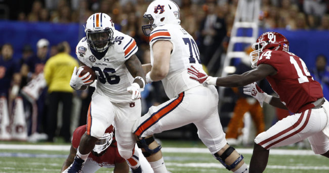 Jan 2, 2017; New Orleans , LA, USA; Auburn Tigers running back Kamryn Pettway (36) carries the ball against the Oklahoma Sooners in the first quarter of 2017 Sugar Bowl at the Mercedes-Benz Superdome. Mandatory Credit: Derick E. Hingle-USA TODAY Sports