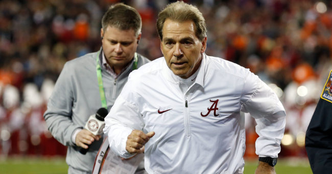 Jan 9, 2017; Tampa, FL, USA; Alabama Crimson Tide head coach Nick Saban  runs off the field after the first half against the Clemson Tigers  in the 2017 College Football Playoff National Championship Game at Raymond James Stadium. Mandatory Credit: Kim Klement-USA TODAY Sports