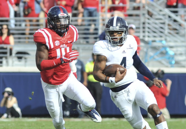 Nov 5, 2016; Oxford, MS, USA; Georgia Southern Eagles quarterback Kevin Ellison (4) carries the ball against Mississippi Rebels defensive end Marquis Haynes (10) during the first half at Vaught-Hemingway Stadium. Mandatory Credit: Justin Ford-USA TODAY Sports