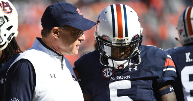 Nov 5, 2016; Auburn, AL, USA; Auburn Tigers head coach Gus Malzahn speaks to quarterback John Franklin III (5) prior to the game between the Auburn Tigers and the Vanderbilt Commodores at Jordan Hare Stadium. Mandatory Credit: Shanna Lockwood-USA TODAY Sports