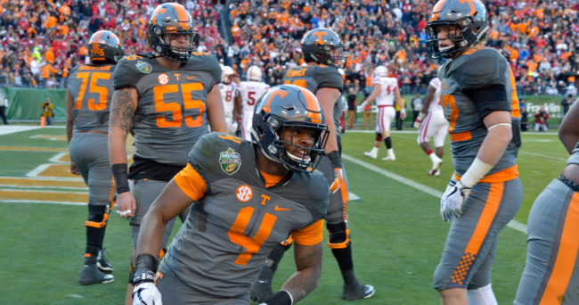 Dec 30, 2016; Nashville , TN, USA; Tennessee Volunteers running back John Kelly (4) celebrates scoring touchdown against the Nebraska Cornhuskers during the first half at Nissan Stadium. Mandatory Credit: Jim Brown-USA TODAY Sports