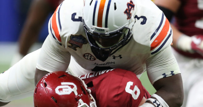 Jan 2, 2017; New Orleans , LA, USA; Oklahoma Sooners quarterback Baker Mayfield (6) is tackled by Auburn Tigers defensive back Nick Ruffin (19) and defensive lineman Marlon Davidson (3) in the fourth quarter of the 2017 Sugar Bowl at the Mercedes-Benz Superdome. Mandatory Credit: Chuck Cook-USA TODAY Sports