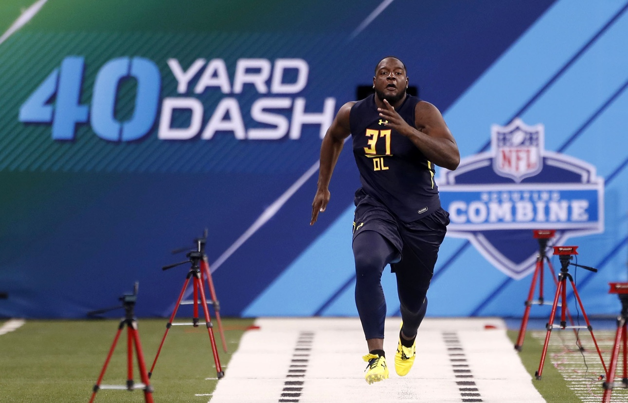 Mar 3, 2017; Indianapolis, IN, USA; Alabama Crimson Tide offensive lineman Cam Robinson (37) runs the 40 yard dash during the 2017 NFL Combine at Lucas Oil Stadium. Mandatory Credit: Brian Spurlock-USA TODAY Sports