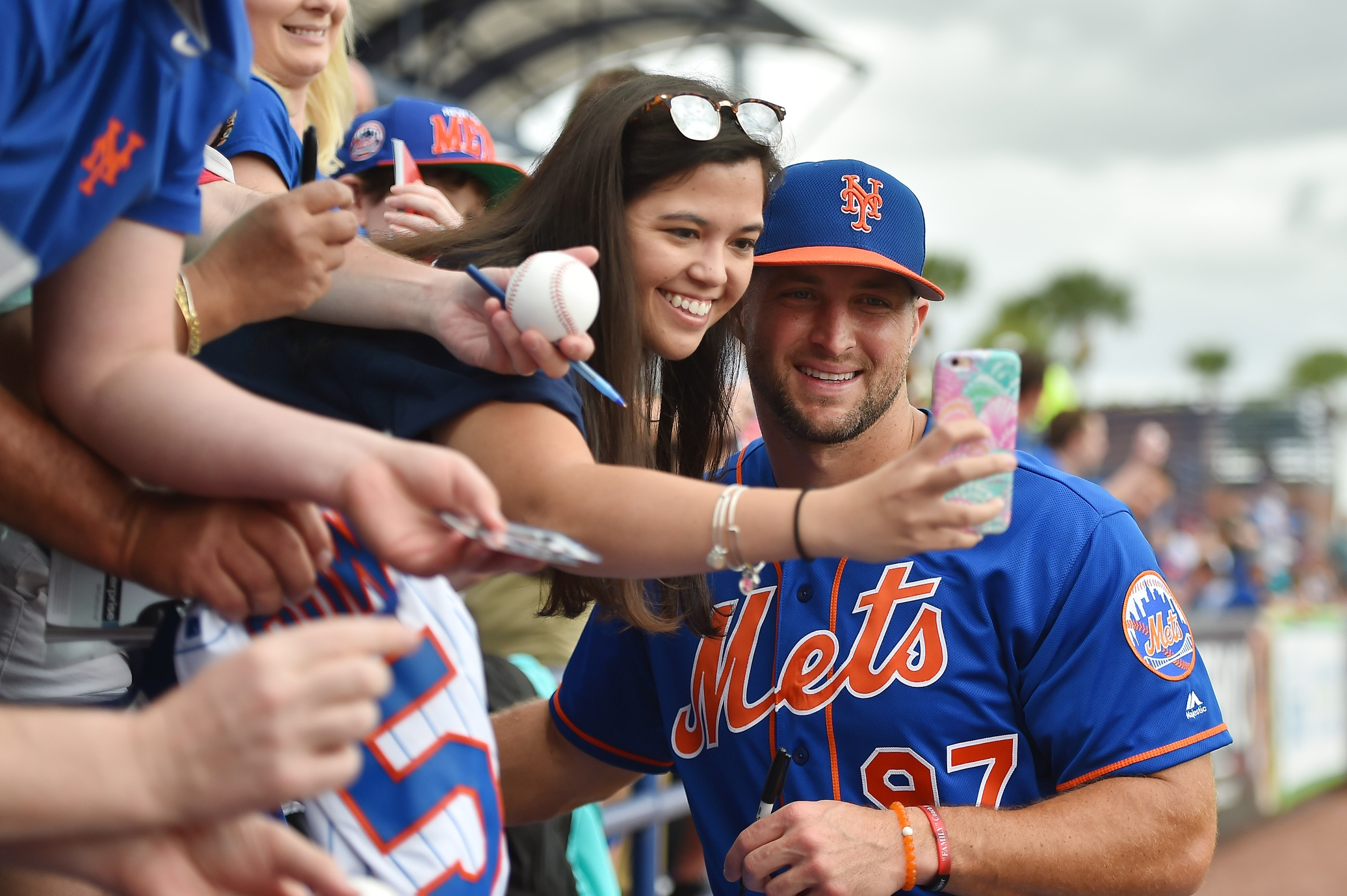 Mar 8, 2017; Port St. Lucie, FL, USA; New York Mets designated hitter Tim Tebow (97) takes a selfie picture with a fan prior to the game against the Boston Red Sox at First Data Field. Mandatory Credit: Jasen Vinlove-USA TODAY Sports