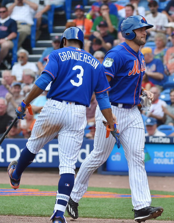 Mar 8, 2017; Port St. Lucie, FL, USA; New York Mets right fielder Curtis Granderson (3) congratulates designated hitter Tim Tebow (97) after his run batted in against the Boston Red Sox at First Data Field. Mandatory Credit: Jasen Vinlove-USA TODAY Sports