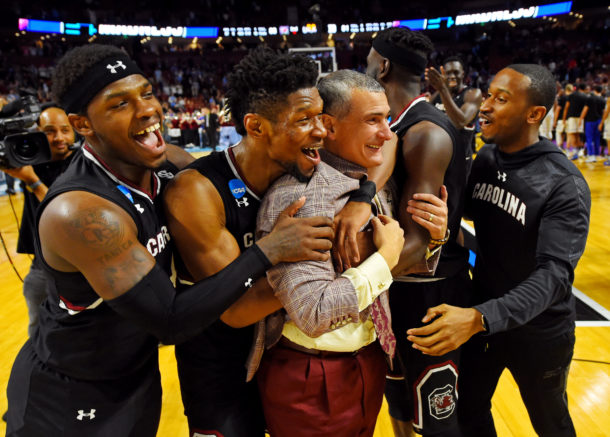 Mar 19, 2017; Greenville, SC, USA; South Carolina Gamecocks guard Rakym Felder (4) and forward Chris Silva (30) celebrates with head coach Frank Martin after beating the Duke Blue Devils in the second round of the 2017 NCAA Tournament at Bon Secours Wellness Arena. Mandatory Credit: Bob Donnan-USA TODAY Sports
