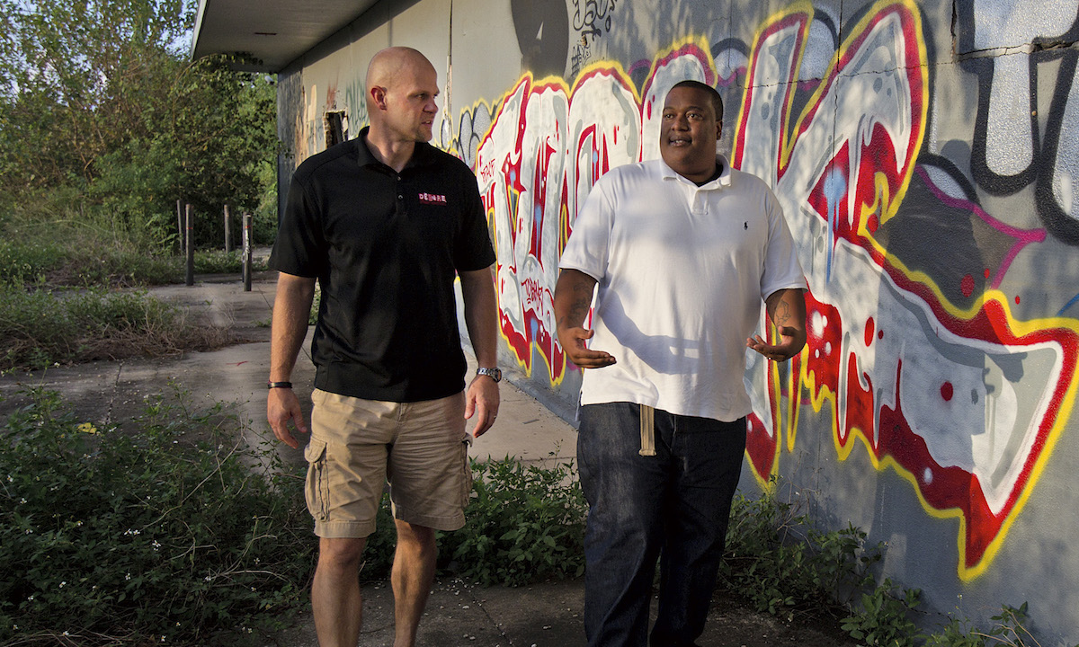 PHOTO BY TED JACKSON  Photo shoot of Danny Wuerffel and Oscar walk and talk the neighborhood around the 9th Ward of New Orleans, near the old Desire Housing Development, Wednesday August 15, 2012.