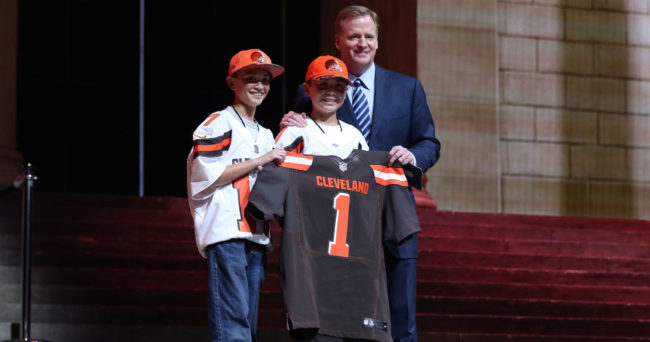 Apr 27, 2017; Philadelphia, PA, USA; NFL commissioner Roger Goodell (right) poses with 2 Cleveland Browns fans as Myles Garrett (Texas A&M), not pictured) is selected as the number 1 overall pick to the Cleveland Browns in the first round the 2017 NFL Draft at Philadelphia Museum of Art. Mandatory Credit: Bill Streicher-USA TODAY Sports