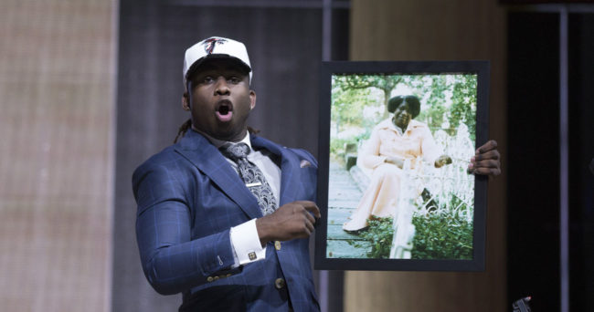 Apr 27, 2017; Philadelphia, PA, USA; Takkarist McKinley (UCLA) holds a photo of his grandmother as he is selected as the number 26 overall pick to the Atlanta Falcons in the first round the 2017 NFL Draft at the Philadelphia Museum of Art. Mandatory Credit: Bill Streicher-USA TODAY Sports