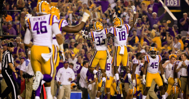 Nov 5, 2016; Baton Rouge, LA, USA; LSU Tigers safety Jamal Adams (33) and cornerback Tre'Davious White (18) celebrate after a interception against the Alabama Crimson Tide during the first quarter of a game at Tiger Stadium. Mandatory Credit: Derick E. Hingle-USA TODAY Sports