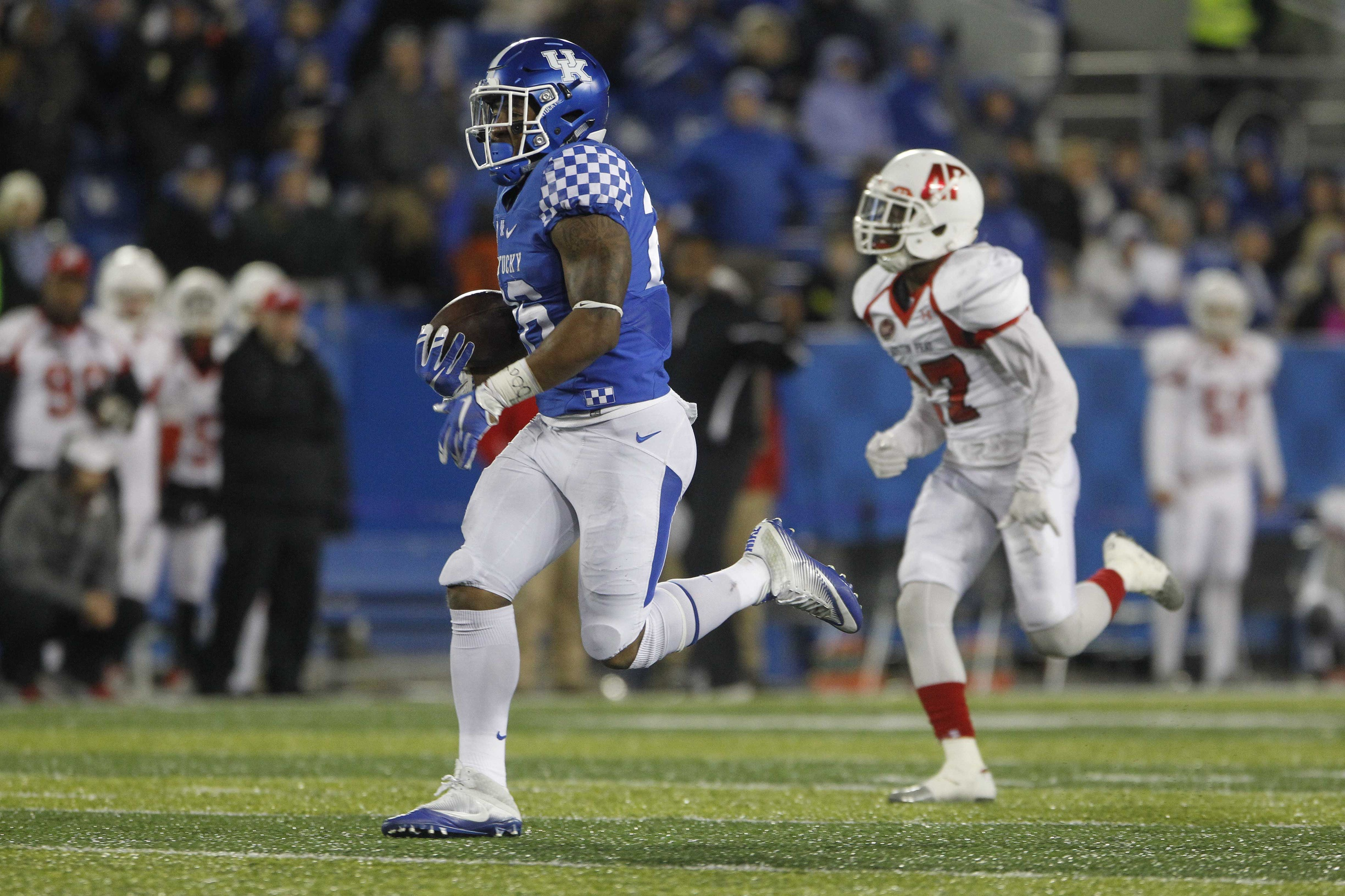 Nov 19, 2016; Lexington, KY, USA; Kentucky Wildcats running back Benny Snell (26) runs the ball against Austin Peay Governors defensive back Rodney Saulsberry (27) in the second half at Commonwealth Stadium. Kentucky defeated Austin Peay 49-13. Mandatory Credit: Mark Zerof-USA TODAY Sports