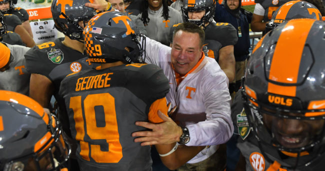 Dec 30, 2016; Nashville , TN, USA; Tennessee Volunteers head coach Butch Jones celebrates with players after a win over the Nebraska Cornhuskers at Nissan Stadium. Tennessee won 38-24. Mandatory Credit: Christopher Hanewinckel-USA TODAY Sports