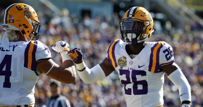 Dec 31, 2016; Orlando , FL, USA; LSU Tigers safety John Battle (26) and linebacker Duke Riley (4) during the first quarter against the Louisville Cardinals at Camping World Stadium. Mandatory Credit: Kim Klement-USA TODAY Sports