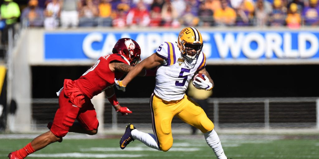 Dec 31, 2016; Orlando, FL, USA; LSU Tigers running back Derrius Guice (5) runs the ball against the Louisville Cardinals during the first half of the Buffalo Wild Wings Citrus Bowl at Camping World Stadium. Mandatory Credit: Jonathan Dyer-USA TODAY Sports
