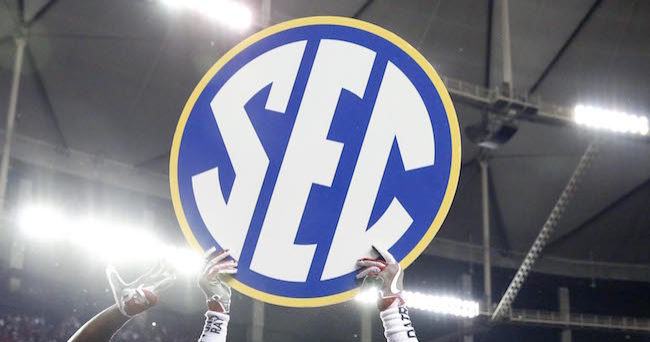 Dec 3, 2016; Atlanta, GA, USA; Alabama Crimson Tide wide receiver ArDarius Stewart (13) holds up an SEC logo after the SEC Championship college football game against the Florida Gators at Georgia Dome. Alabama defeated Florida 54-16. Mandatory Credit: Jason Getz-USA TODAY Sports