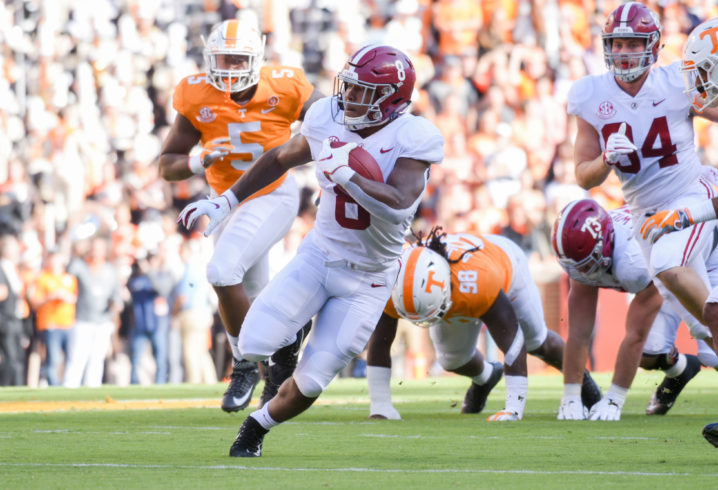 Tua tosses four TDs in Tide win
